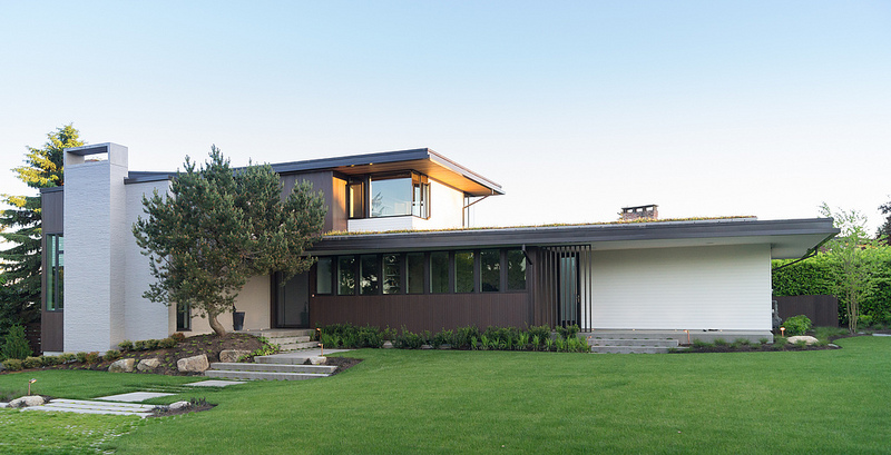 Sunrise vista exterior with grass lawn in foreground